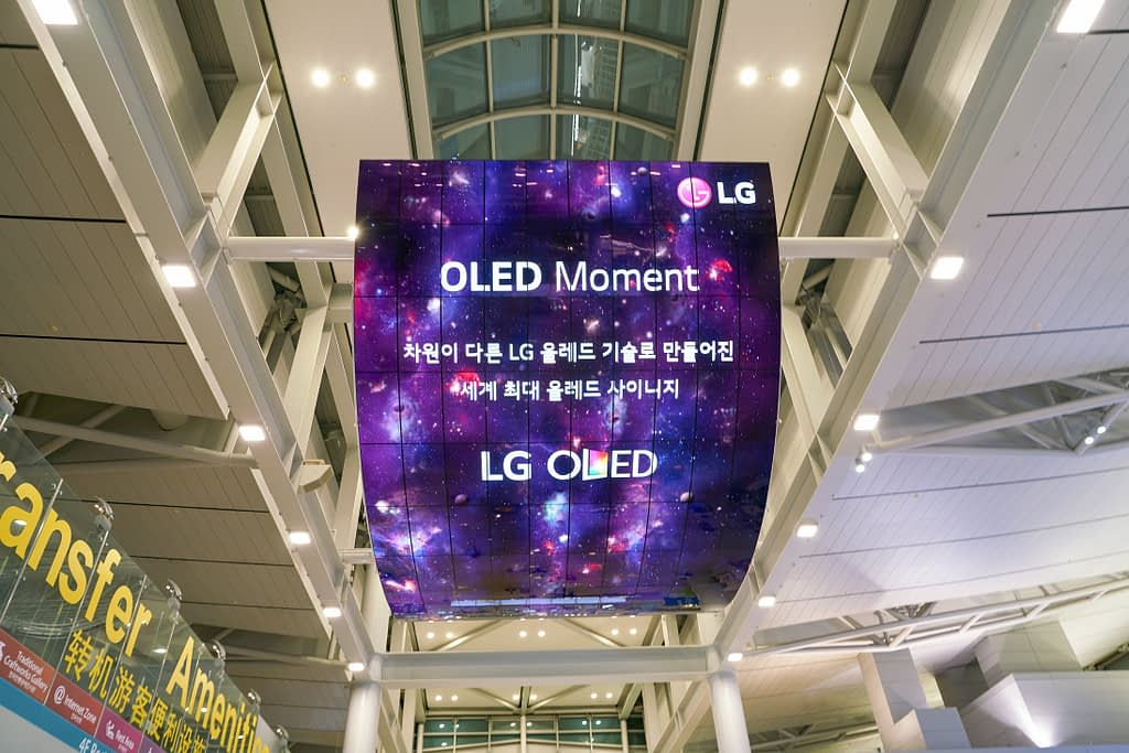 LG OLED Digital Sign in an airport check in area