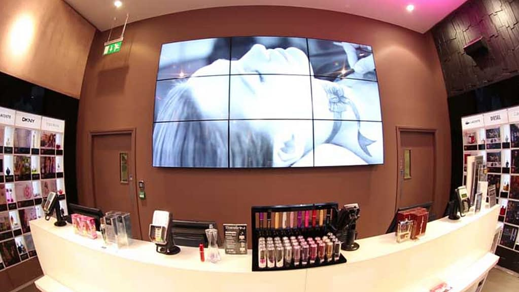 Indulge fragrance store behind the counter is a digital display