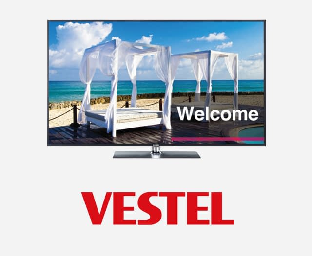Vestel Hospitality Screens showing a bed on a tropical beach