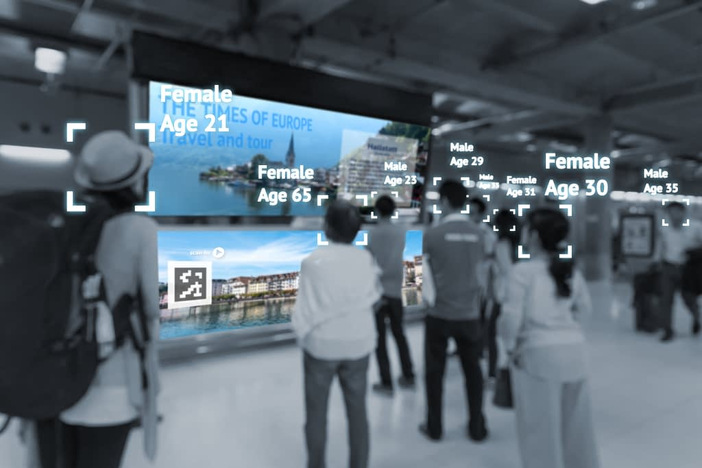 Digital Trends in signage, a group of people viewing a large wall screen