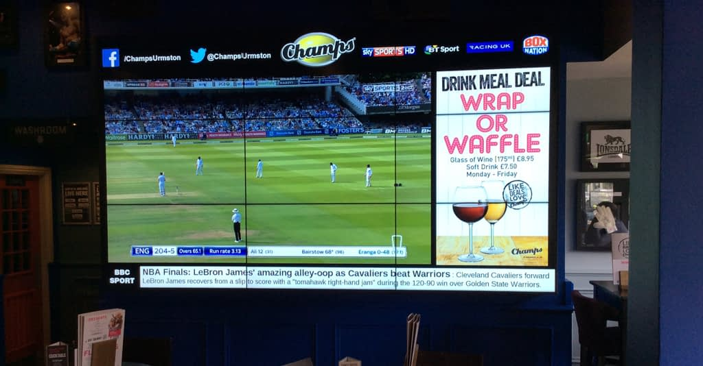 Samsung Video Walls in a bar showing a cricket game